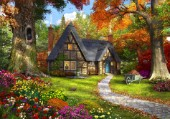 A small cosy cottage in a Autumnal woodland.
